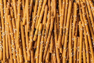Salty sticks. Crunchy pretzels with sesame seeds.