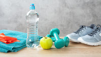 Fitness equipment on a wooden background