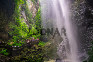Crowds under waterfall in Wulong National Park