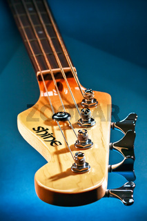 Close-up Electric Bass Guitar Head and Tuning Pegs