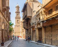 Moez Street with minaret of Qalawun Complex historic building, Cairo, Egypt