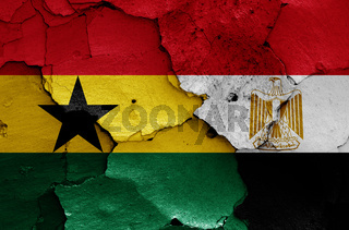 flags of Ghana and Egypt painted on cracked wall