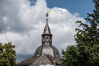 Spire of the Siegen castle with metallic weather vane