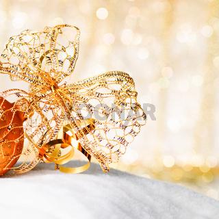 Gold Christmas ball and bow