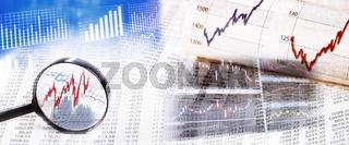 Börsenkurse mit Lupe und Monitor