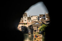Tourists in old wooden boat in Fenghuang