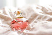 Perfume bottle with aromatic floral scent, luxury fragrance