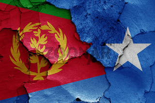 flags of Eritrea and Somalia painted on cracked wall