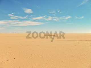 desert landscape with blue sky with clouds