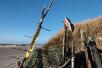 AMRUM, GERMANY - DECEMBER 31, 2020: On the Kniepsand Beach of  the North Frisian Island Amrum in Germany Land-Artists made Beach Huts and other Objects out of Flotsam and Jetsam