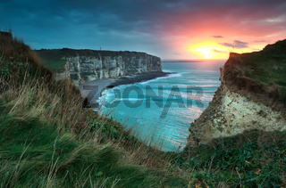 warm sunset over cliffs and ocean