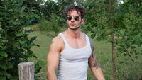 Muscular Hunk Man Outdoor in Countryside with Tanktop
