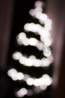 Abstract Christmas tree built with blurred Christmas lights
