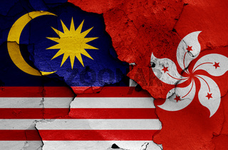flags of Malaysia and Hong Kong painted on cracked wall