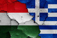 flags of Hungary and Greece painted on cracked wall