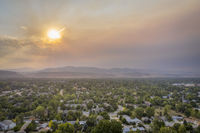 wildfire smoke from Cameron Peak Fire over Fort Collins