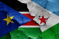flags of South Sudan and Djibouti painted on cracked wall