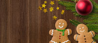 Gingerbread men and christmas decorations and copy space