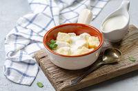 Cottage cheese gnocchi in sour cream sauce.