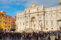 The world famous Trevi Fountain crowded with tourists