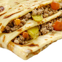 Pancake with meat and vegetables isolated on white