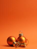 Orange vintage Christmas baubles on an orange background