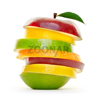 Green, yellow and red fruits sliced in pieces isolated on white background