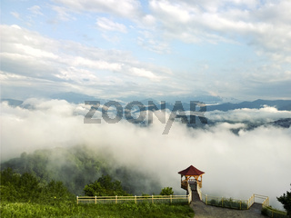 Mountain and cloud landscape with gazebo viewpoint