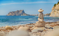 Art of stone balance, piles of stones on the Cala Baladrar beach. Costa Blanca. Spain