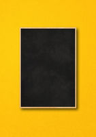 Traditional black board isolated on a yellow background