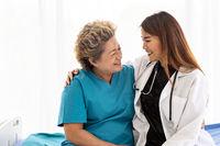 doctor hugging elderly patient