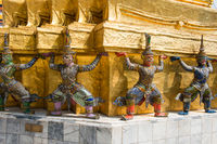 Statues of guards at Temple of Emerald Buddha in Bangkok