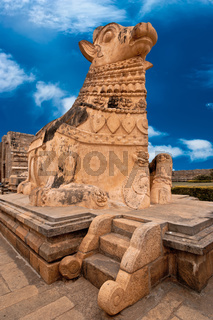 Big statue of Nandi Bull in front of Hindu Gangaikonda Cholapuram Temple. In Hinduism Nandi is a Shiva vehicle. South Indian architecture. India, Tamil Nadu, Thanjavur (Trichy)  Stock Photo: