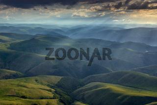 Sunbeams on hills in Caucasus mountains