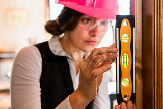 close up on woman using a Spirit level