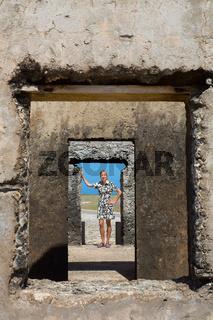 Woman standing in doorway of historic building