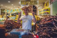 Happy food seller in Fenghuang Old Town