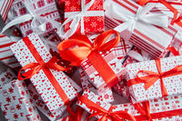 Christmas concept. Close up on festive paper wrapped gifts with ribbon