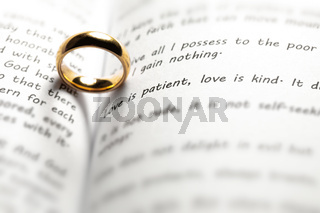 Golden wedding ring on bible book