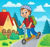 Boy on kick scooter theme image 2