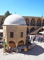 A group of tourists in the old souk in Nicosia Cyprus surrounded by shops and cafes