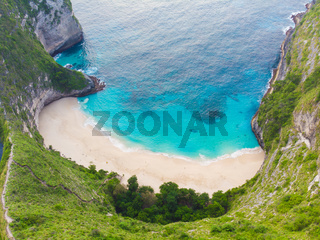Beautiful viewpoint of Kelingking beach in Nusa Penida island, Bali, Indonesia. Drone view.