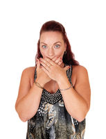 Woman holding her hands over her mouth, is embarrass