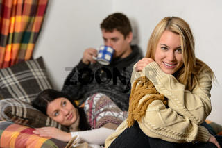 Young friends spend winter holiday cozy cottage