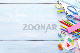Colorful stationery on blue desk