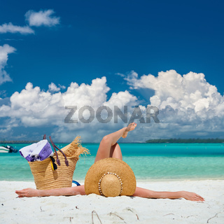 Woman lying down on beach