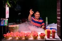 Happy fruit seller in Ci Qi Kou Old town in Chongqing