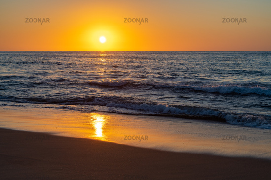 Colorful dawn over the deep blue sea