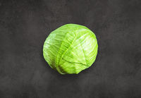 Green cabbage on concrete background