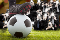 many photographer taking winner soccer player feet on field
